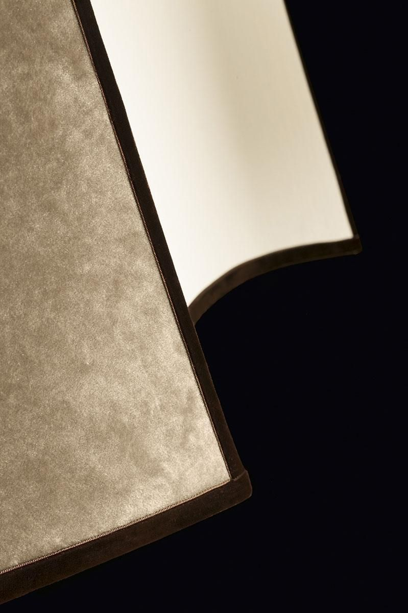"""Detail of the Pentagono lighting collection by Oasis, designed to fit gracefully into the most sophisticated interiors. Through its sand cotton lampshade, finished in rich, luxurious velvet, with a velvet grosgrain border for décor, """"Pentagono"""" sheds a soft, comfortable light which imparts an immediate relaxing effect to the ambient it inhabits."""