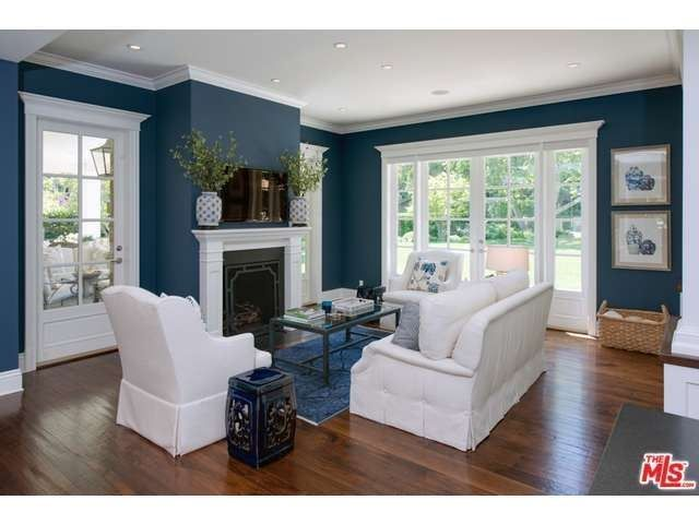 Dramatic Dark Blue Walls With Bright White Trim And Furniture