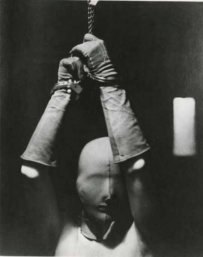 Man Ray - Woman in Mask and handcuffs (1928)