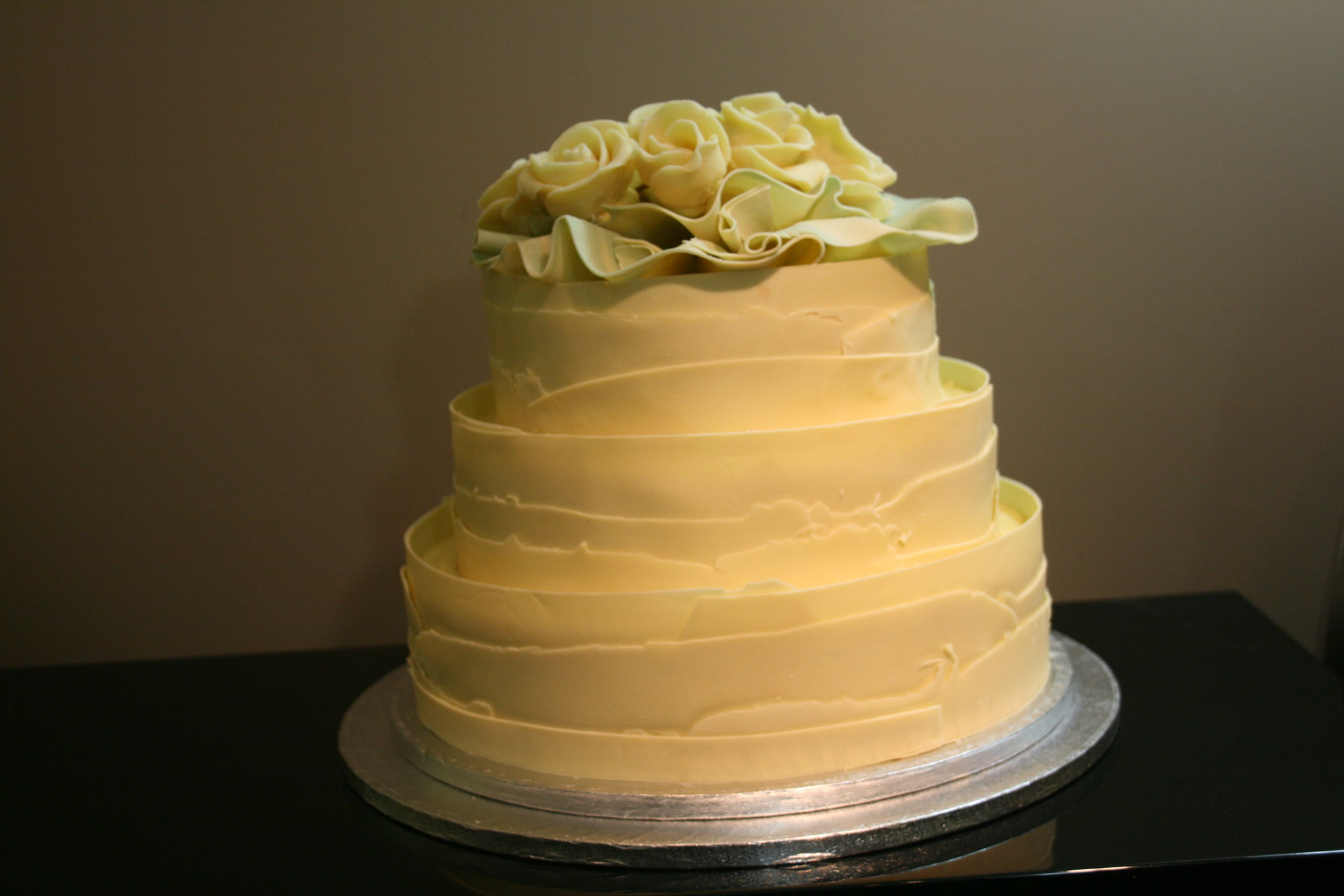 A 3 tiers of #whitechocolate wrap, to give a rustic finished #weddingcake...