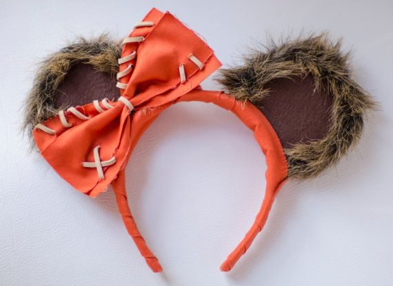 Mickey Mouse Ear Headband Inspired by Star Wars Wicket Ewok  These ears are covered with a brown faux fur, brown felt, and orange fabric. The ears