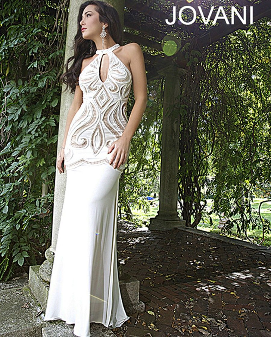 Artsy nude panels accent the jovani prom dress framing the