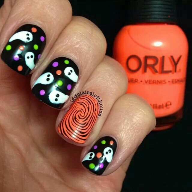 Ghost nail art. And I'm really liking the finger print accent nail too.