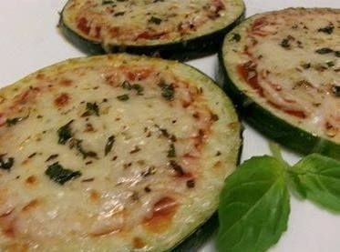 Ingredients  1 Zucchini  Shredded Mozzarella  Spray Olive Oil  Shredded Parmesan  Salt and pepper  Dried Oregano  Fresh Basil chopped  Pizza Sauce    Cut zucchini about 1/8 inch thick. Spray each side with olive oil and season with salt and pepper. Broil or grill each side for