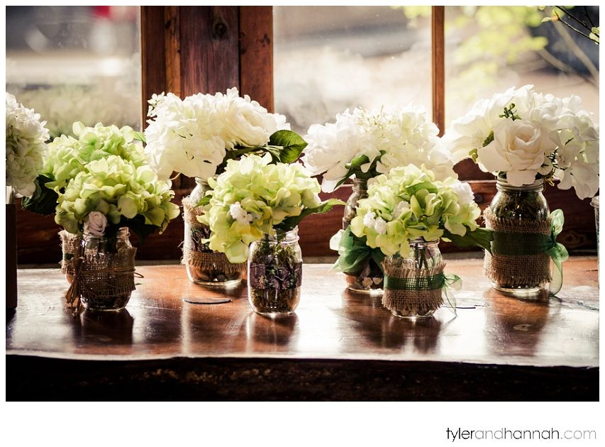 Mason Jars With Assorted Rustic Decoration As Vases Throughout This Wedding Reception Tyler And