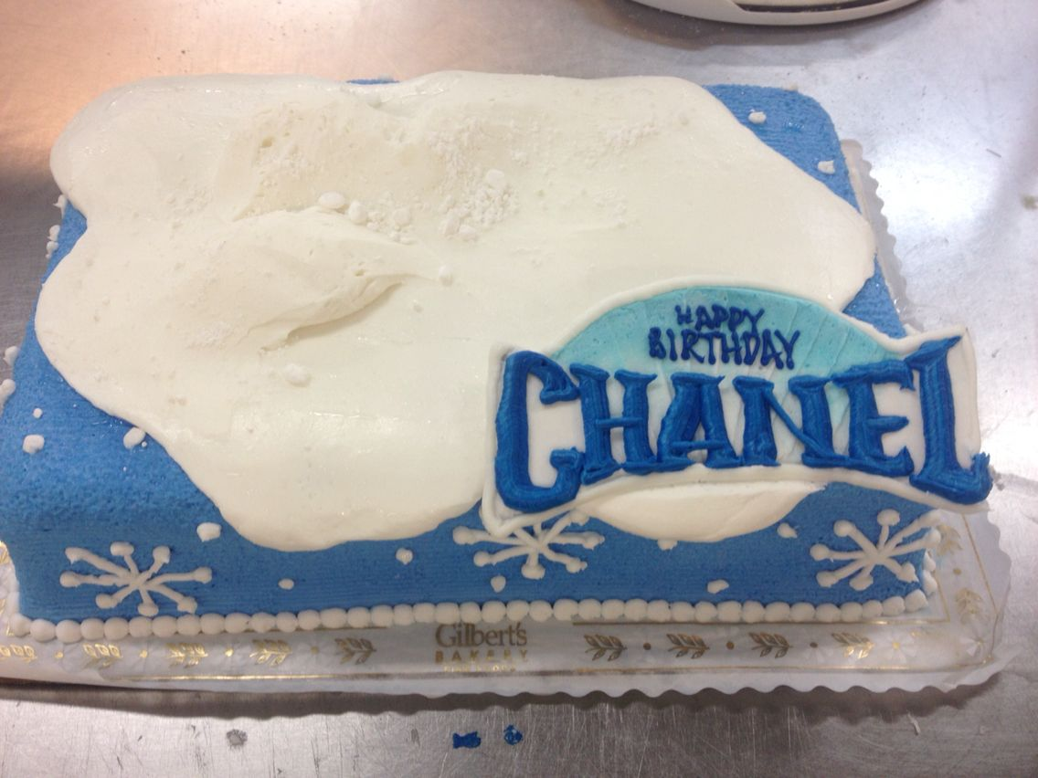 Simple frozen themed cake with details like snow caps and snow ...