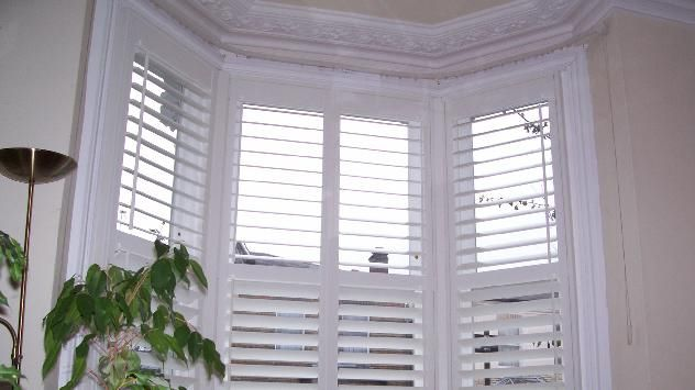 White Wooden Venetian Blinds For Our Bay Windows Window