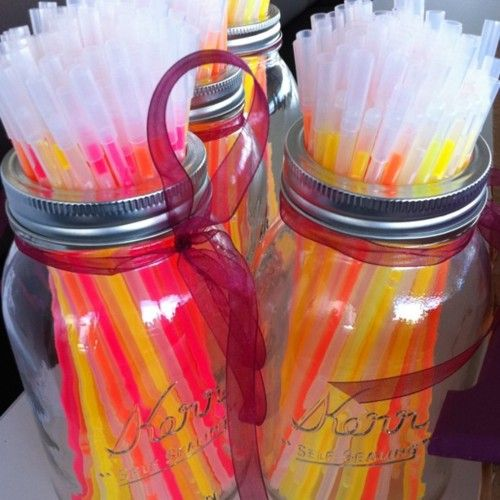 glow sticks in mason jars -- party favors.  great for going outside to make smores at the reception!!
