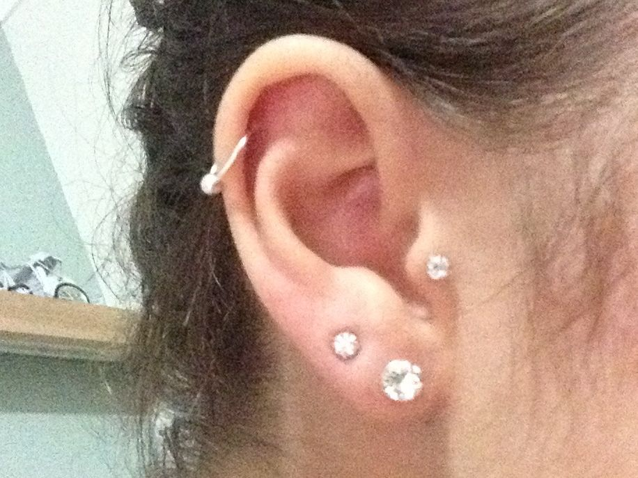 firsts seconds tragus and a helix piercing silver and swarovski