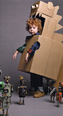 Uh oh, it's the cardboard childasaur. (Halloween costume idea this year for your little ones?)