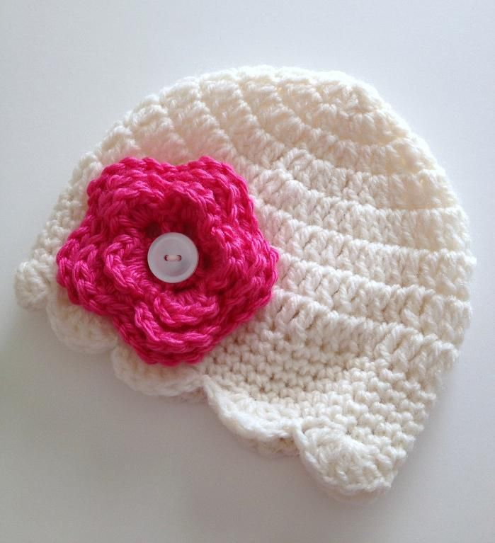 i may have to buy this pattern. Newborn Baby Hat & Button-On Flower ...