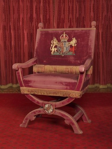 X Shaped Throne Chairs With Arms In Tudor Style Covered In Red Velvet;  Embroidered White Tudor Rose At.