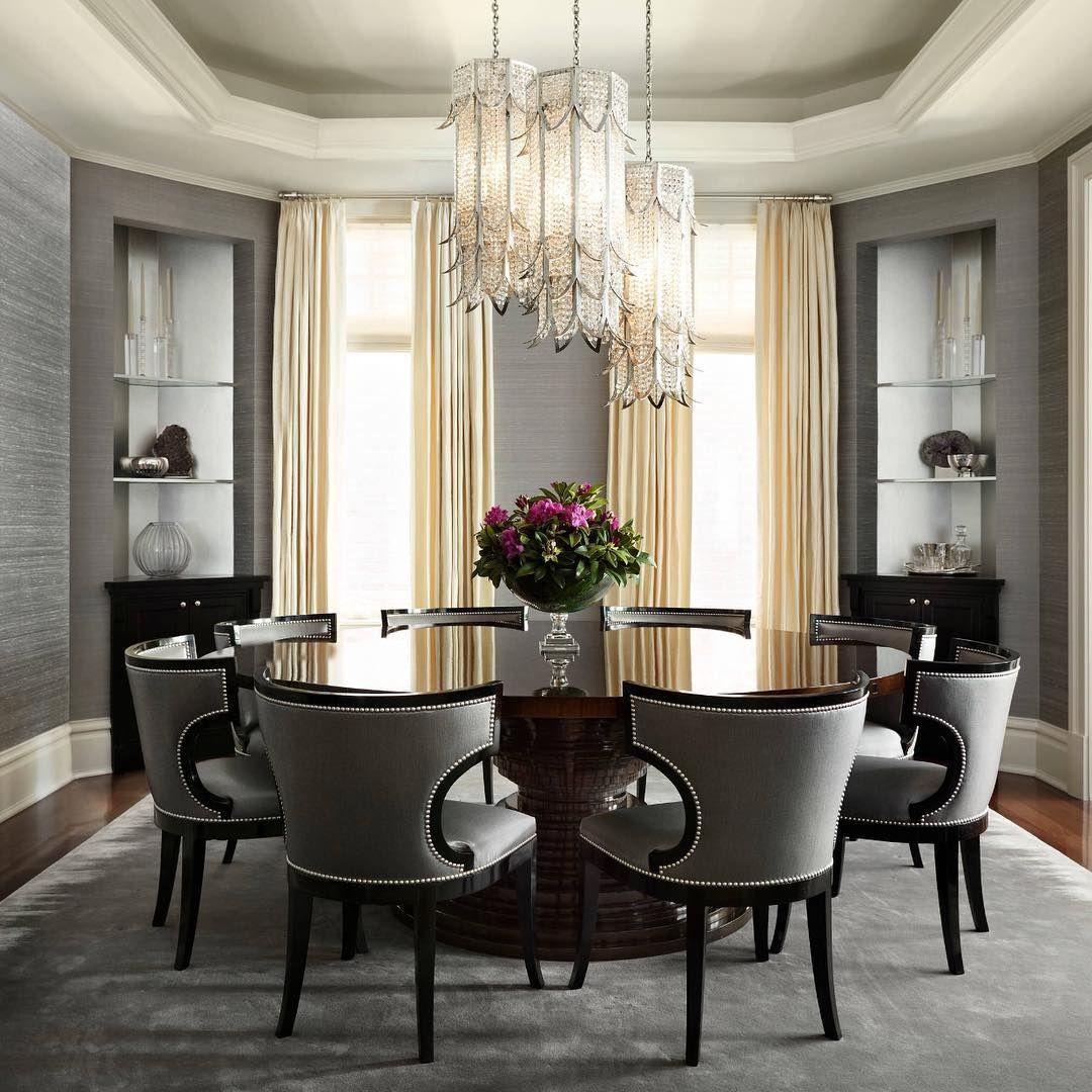 Gray Wallpaper, Dark Hardwoods, Round Table, And Striking Light Fixtures.  Gray Dining RoomsElegant ...