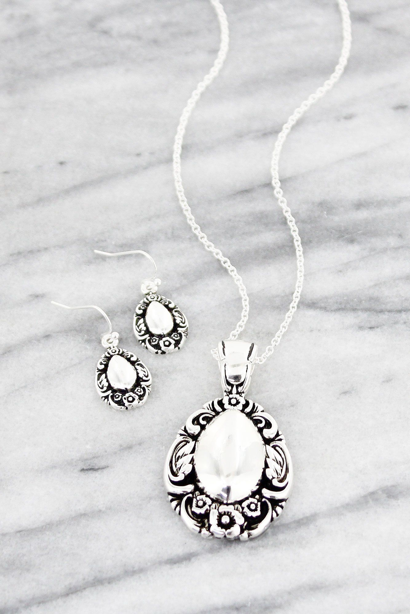 Silvertone oval spoon pendant necklace and earring set products