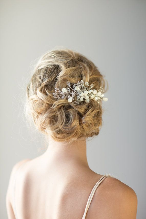 beach wedding hair comb this handcrafted hair comb is perfect for a beach wedding it has mother of pearl flowers with crystal and rhinestone