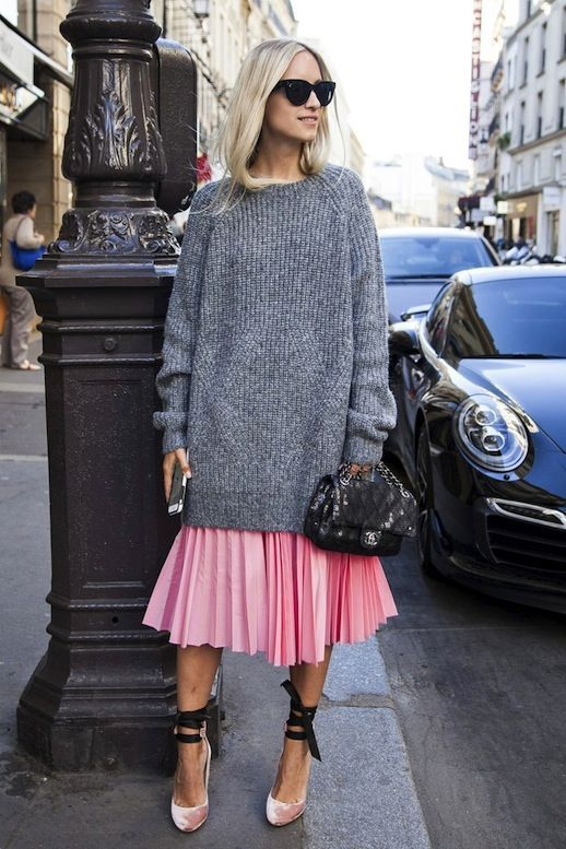 Follow my boards on Pinterest. ❤. Maite. Photo via: The Outfit Blogger Charlotte Groeneveld knocks it out of the park in her cat-eye sunglasses, oversized grey chunky sweater, sequined Chanel bag, bubble gum pink pleated skirt and ballet-ins
