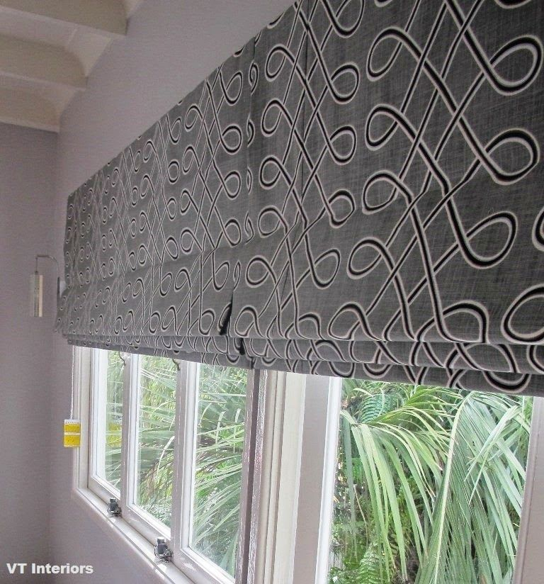The use of a wide roman shade to cover 3 or more windows for Roman shades for wide windows
