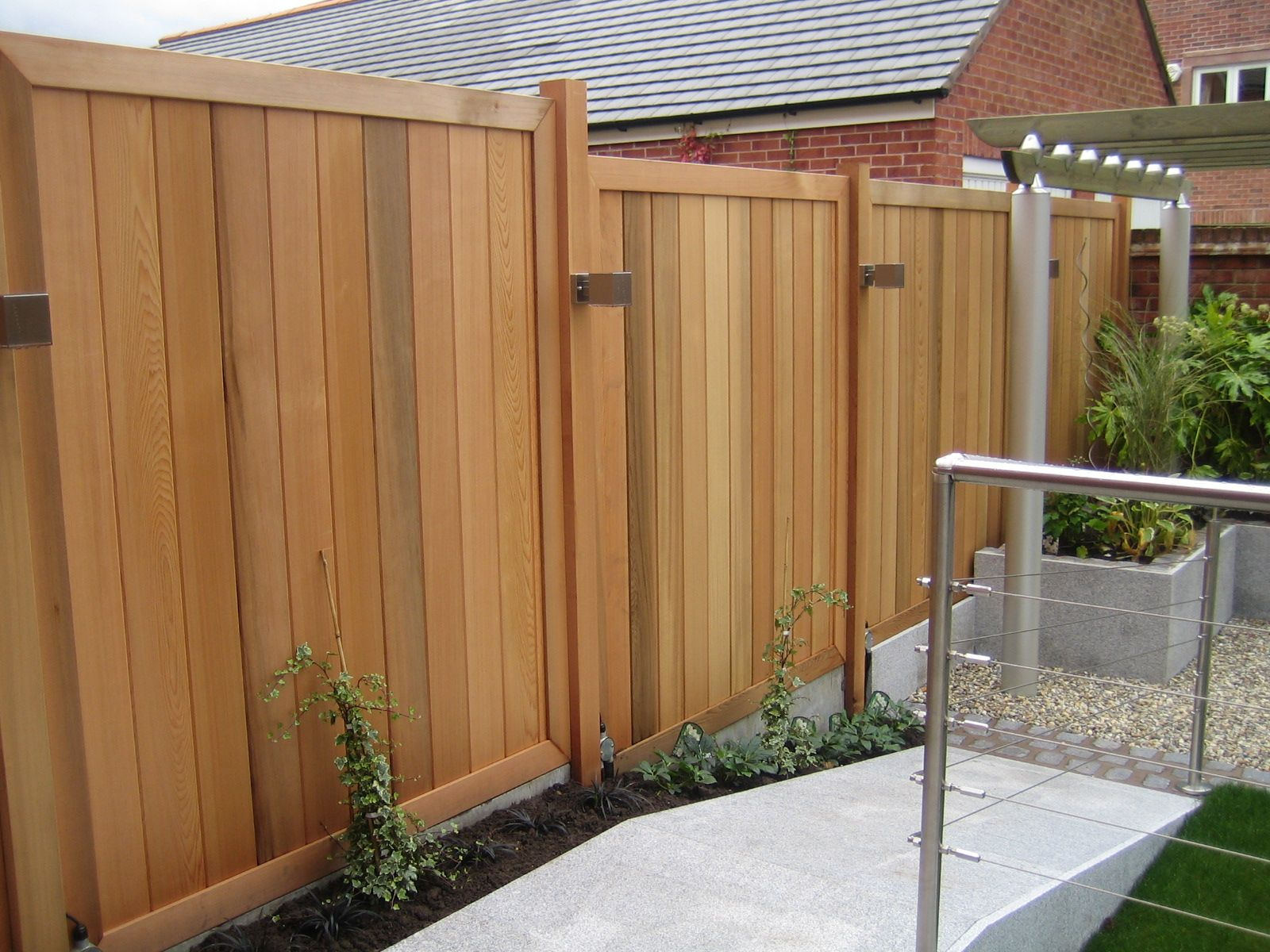 contemporary cedar fencing panels and posts with stainless steel