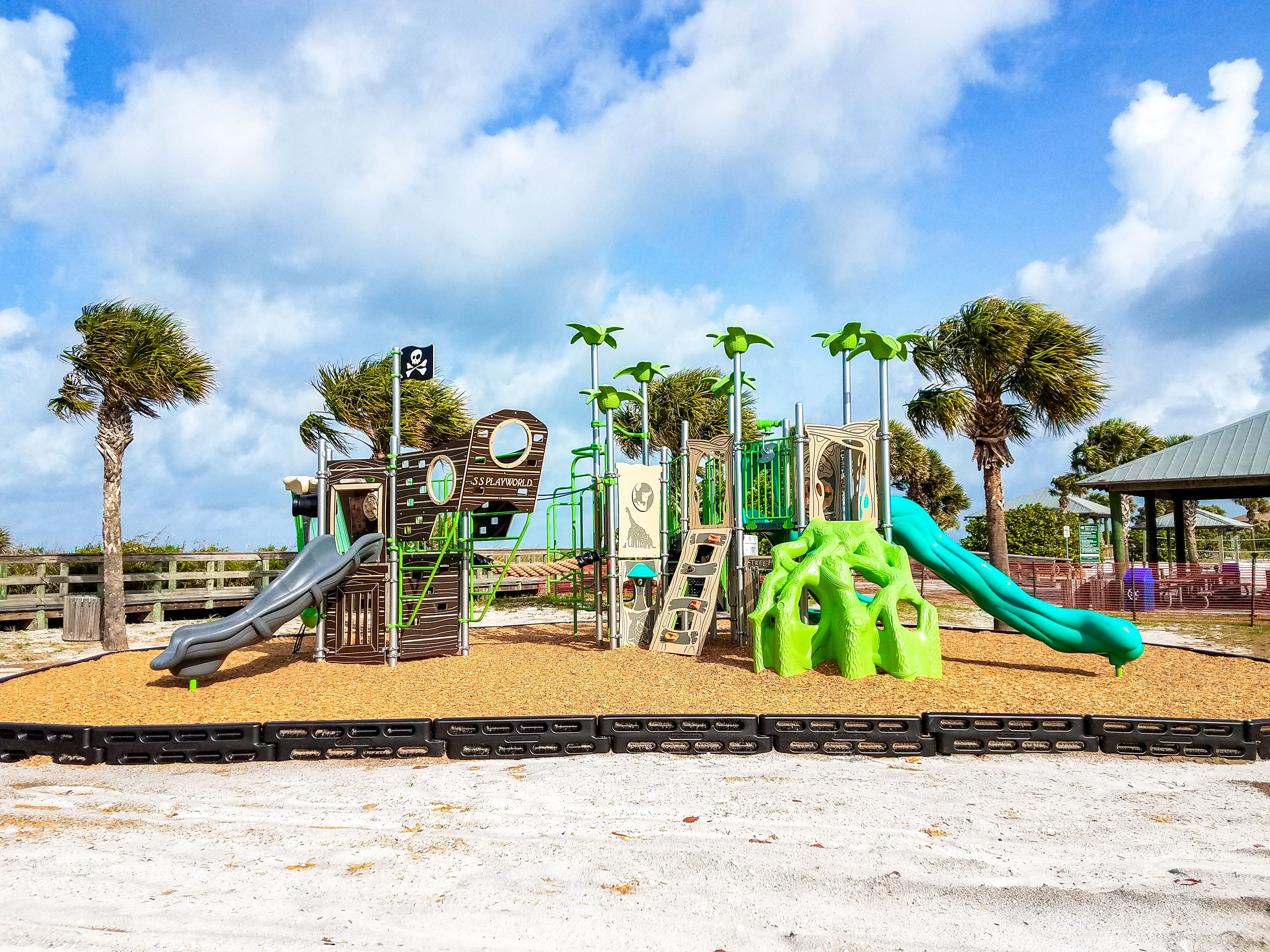 The kids enjoy not only the beach but the playground at ...