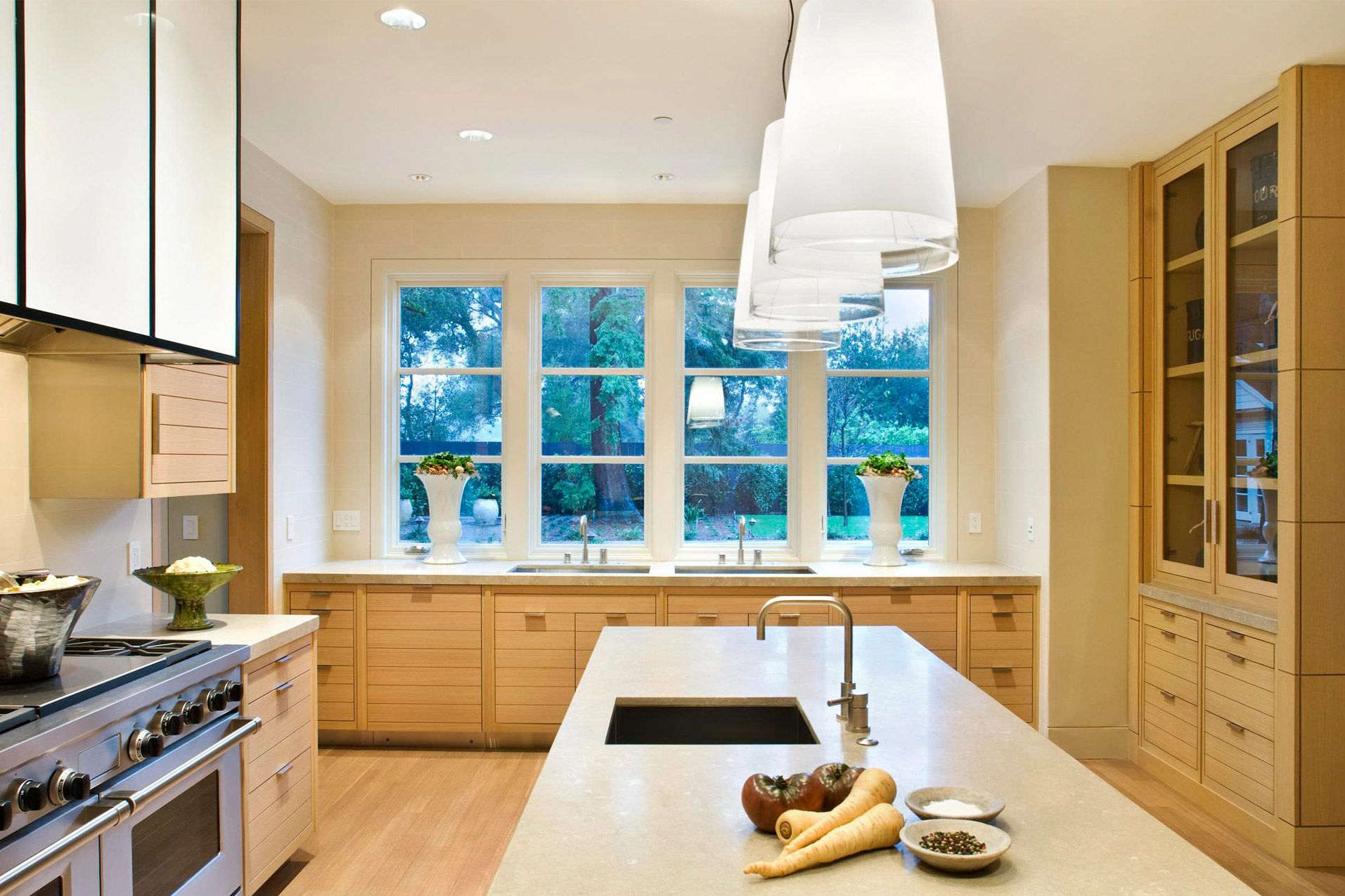 Pacific Peninsula Group: wall of windows above sink; glass storage ...