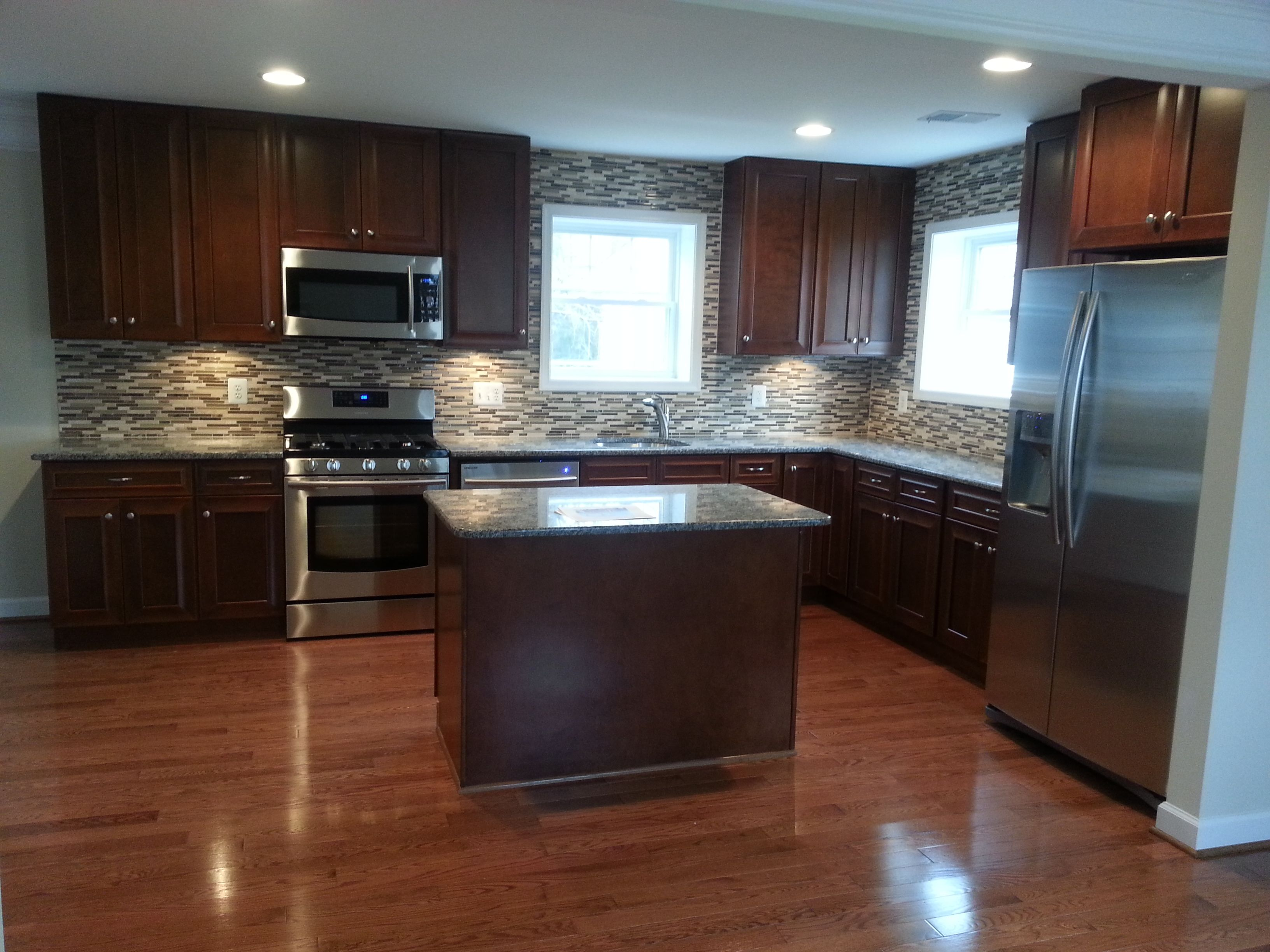 Kitchen with oak hardwood floors, maple granite