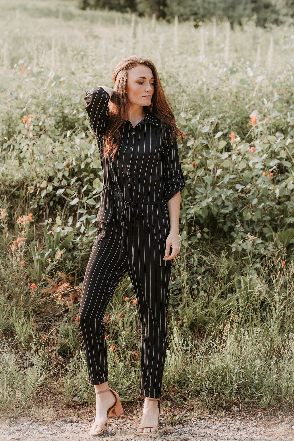 315a190b8b7 The Carbon Striped Button Up Jumpsuit in Black in 2019
