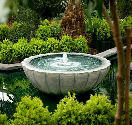 A bubbler set in a basin gently churns the surface of the water, providing a primarily visual experience—and a strong magnet for birds and butterflies. Because the water doesn't tumble down the side, bubblers are probably the quietest fountains. They lose very little water to splashing or wind, minimizing your refilling duties.