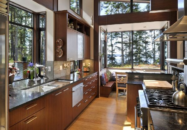Idea for kitchen remodel. Love the booth by the window and the lack over overhead cabinets.