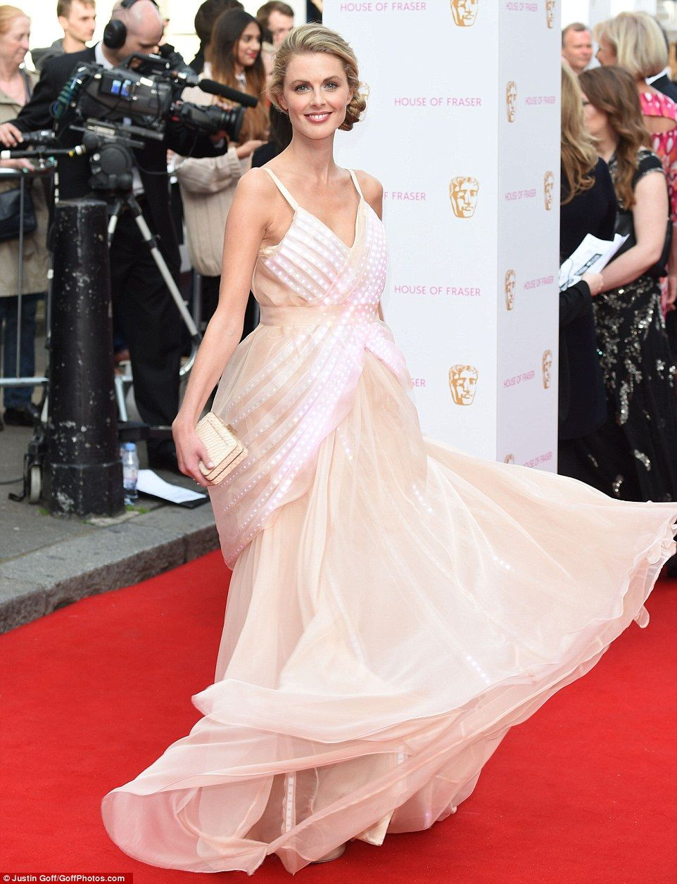 Elegant: The blonde beauty couldn't help giving a twirl on the red carpet in her elegant number from the high street