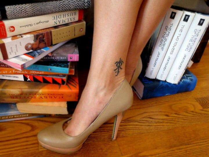 I have the same Lord of the Rings book set and she's def winning with the J. R. R. Tolkien tattoo.