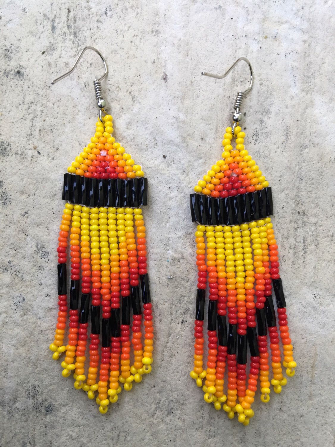 A personal favorite from my Etsy shop https://www.etsy.com/listing/271604691/huichol-beaded-earrings-275-long