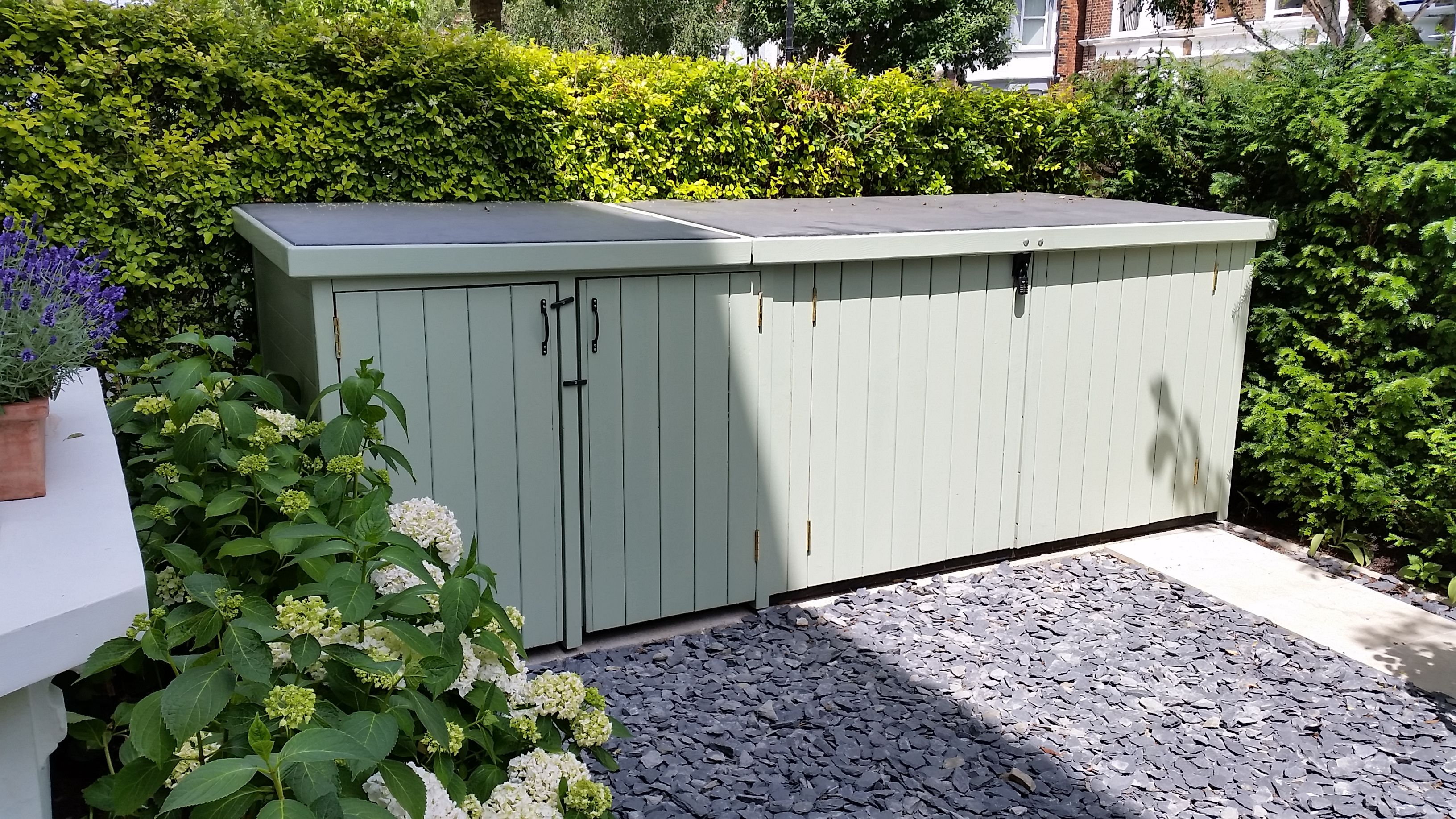 beautiful wooden bike shed with additional wheelie bin storage