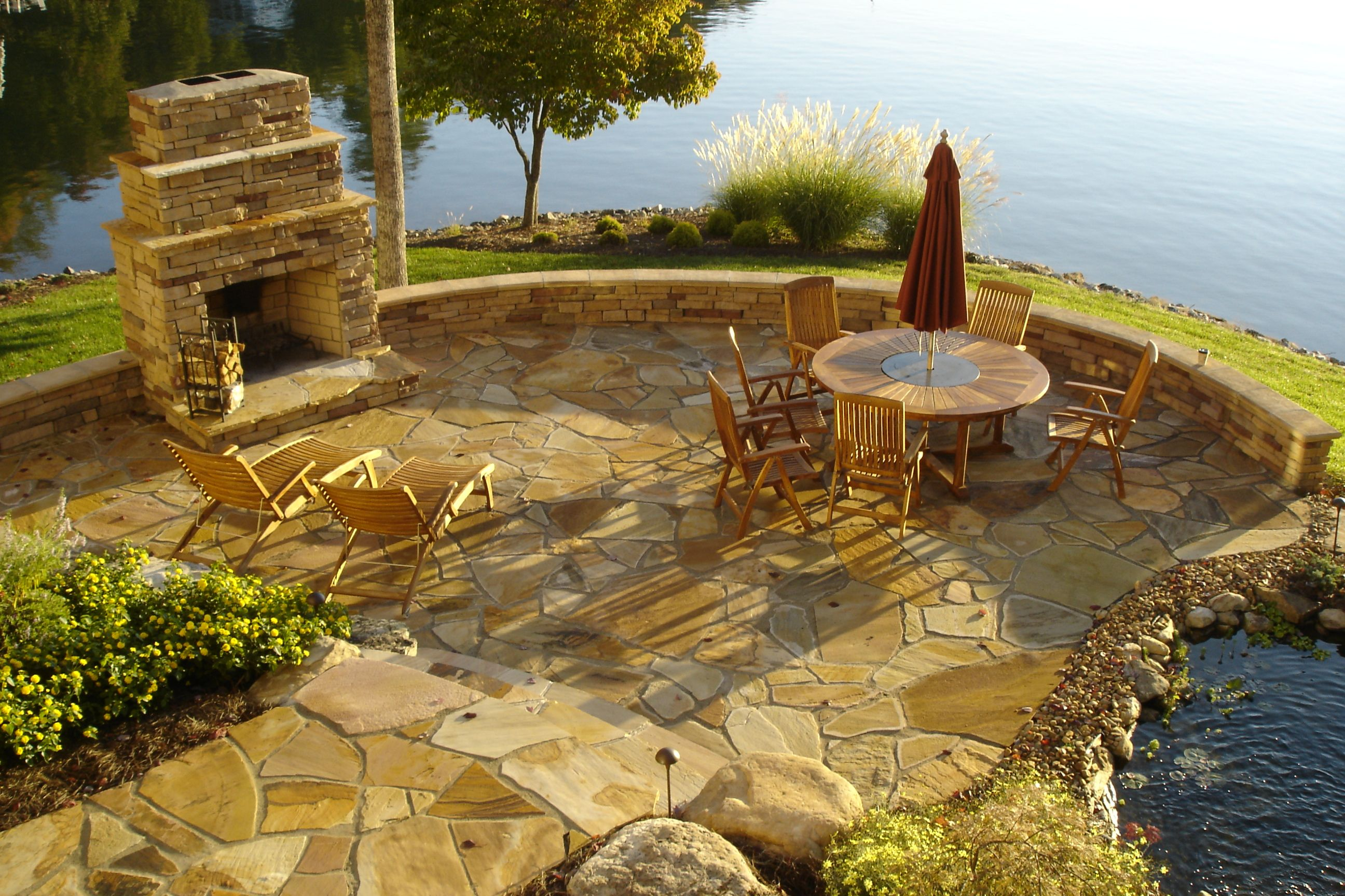 outdoor stone firepit overlooking lake fireplaces fire pits