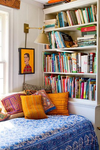 such a beautiful #reading area. Beautiful bright colours of the #cushions matching the #art.