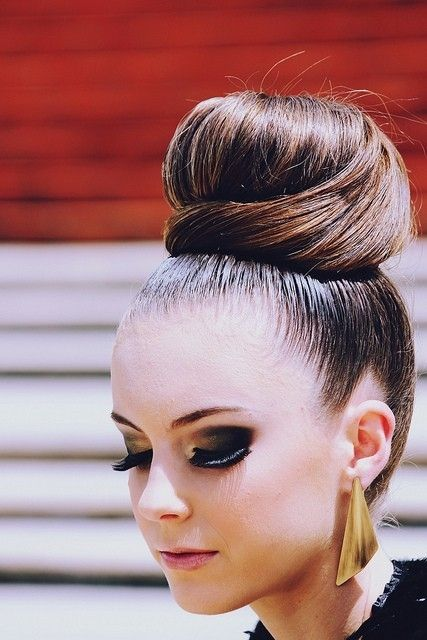 Beautifully neat, thick, and very high up bun. Posh, clean look to try Down Under as sloppy, centered high buns are all the rage in Australia.