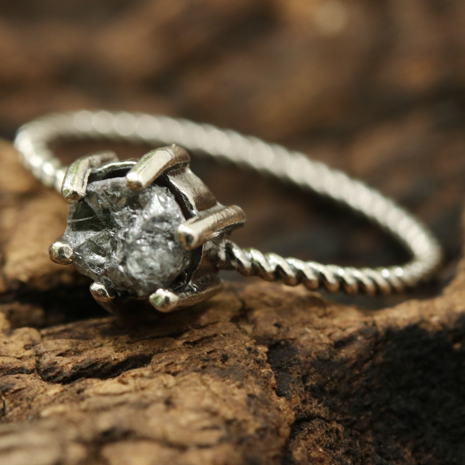 Engagement ring rough diamond in silver prongs setting with oxidized sterling silver twist design band