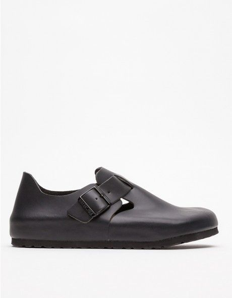 8217a2fea31c Completely enclosed leather shoe from Birkenstock with sleek all-black  detailing. Features adjustable strap