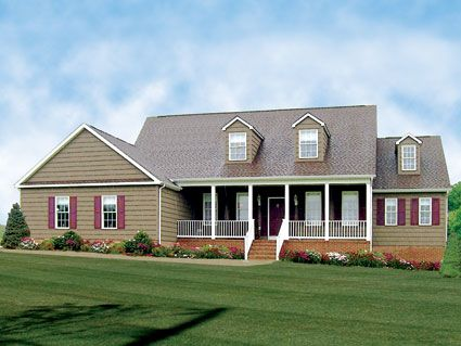 This cape style home has a great room with large corner for Large cape cod house plans