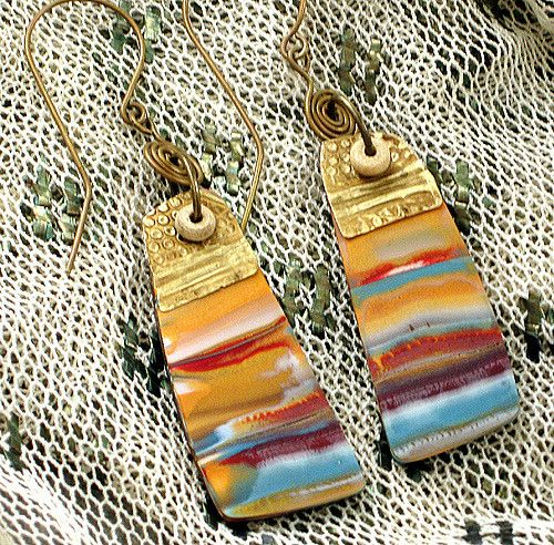 https://flic.kr/p/7i8vDE | Hatshepsut's Earrings Polymer Clay | I was thinking of the intense colors of Egyptian tomb paintings with these-- ocher, azure, vermilion, gold. Used some repurposed Victorian bronze stamped molding for the tops, with bone spacers.  Available for sale in my Etsy shop: www.storiestheytell.etsy.com  For more on my process, visit my blog at : storiestheytell.blogspot.com