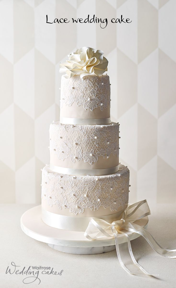 This stunning ivory wedding cake is covered in sugar paste icing and ...
