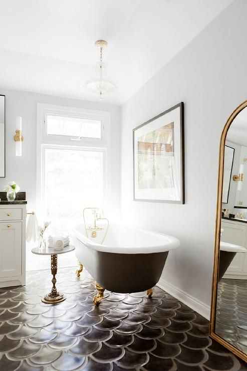 Black And Gold Bathroom Features A Vintage Clawfoot Tub Painted