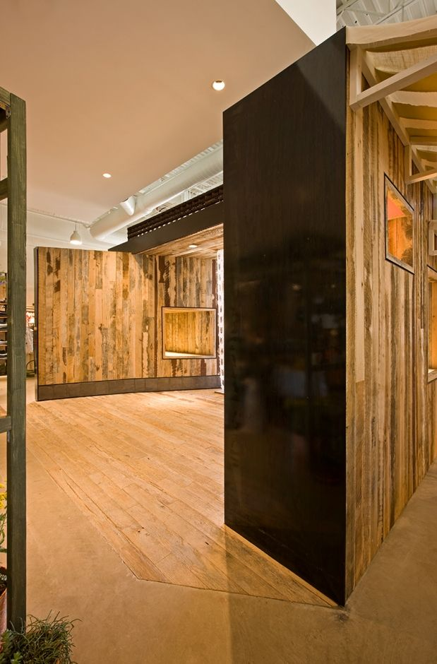 Reclaimed wood and blackened steel define the form of this ...
