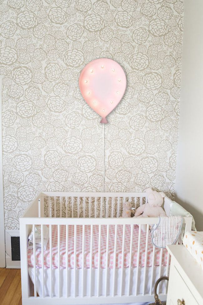 Balloon-shaped marquee sign hung above crib - Decoist