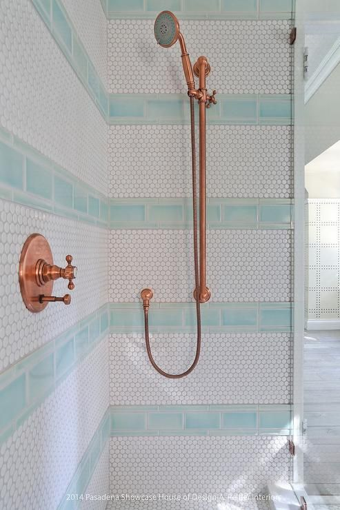 Blue And White Kid S Walk In Shower Features An Eye Catching Copper Shower Kit Mounted To White Hex Wall Tiles Ac Glass Tile Shower Shower Tile Blue Glass Tile