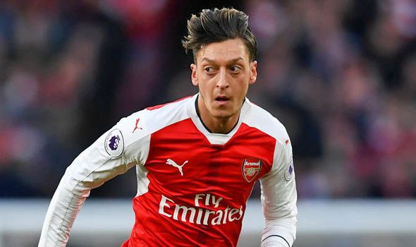 Mesut Ozil I will sign a new Arsenal contract on one condition via