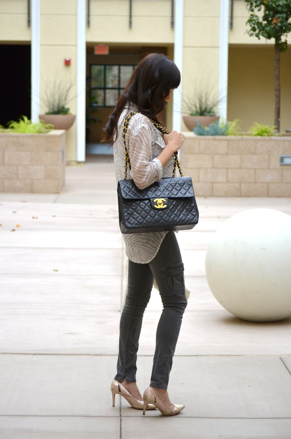 4964a5c19fcd A review of the Jumbo XL Chanel bag in black lambskin with gold hardware.