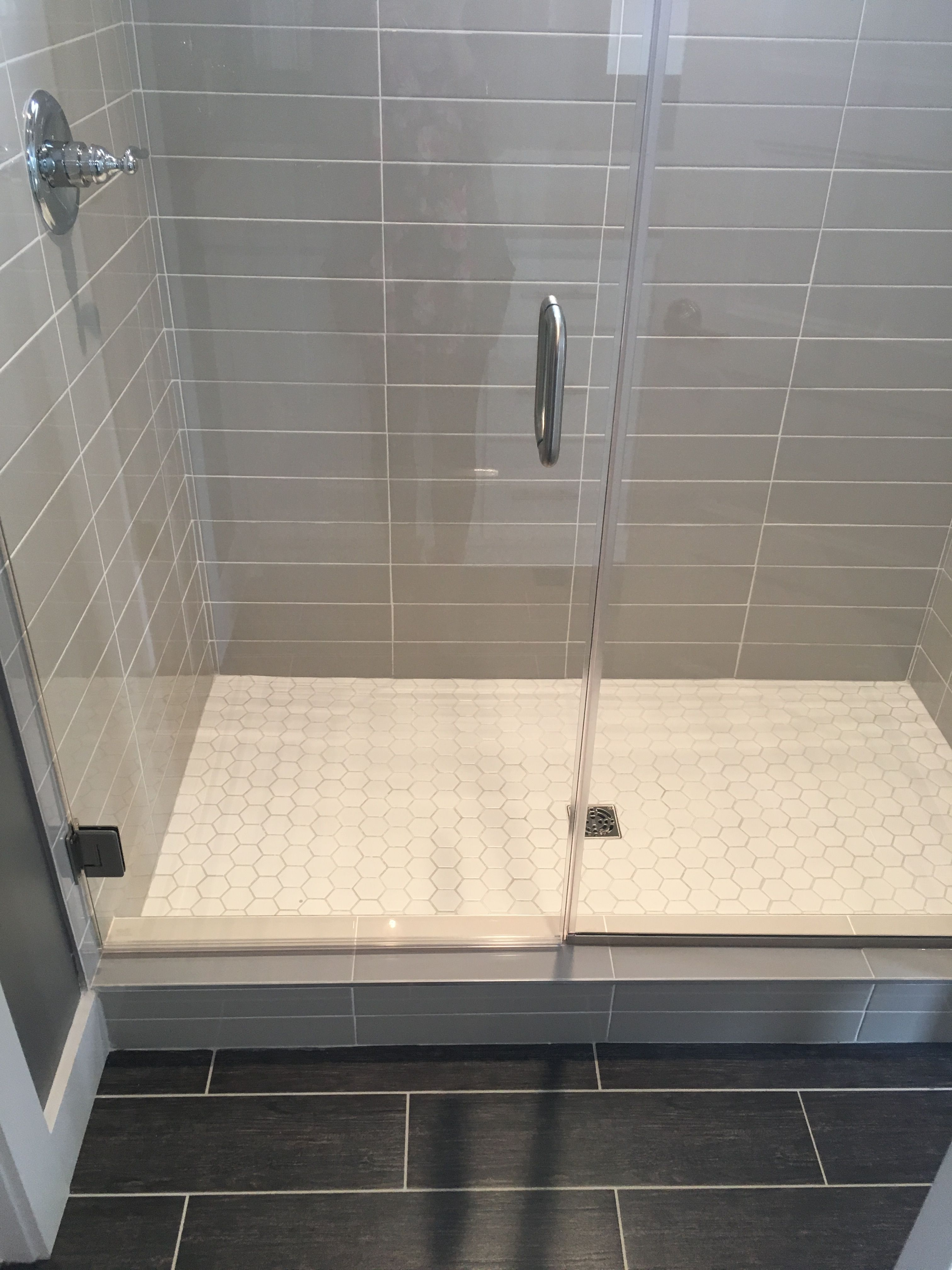 Gray 4x16 subway tile stacked with white hex shower floor ...