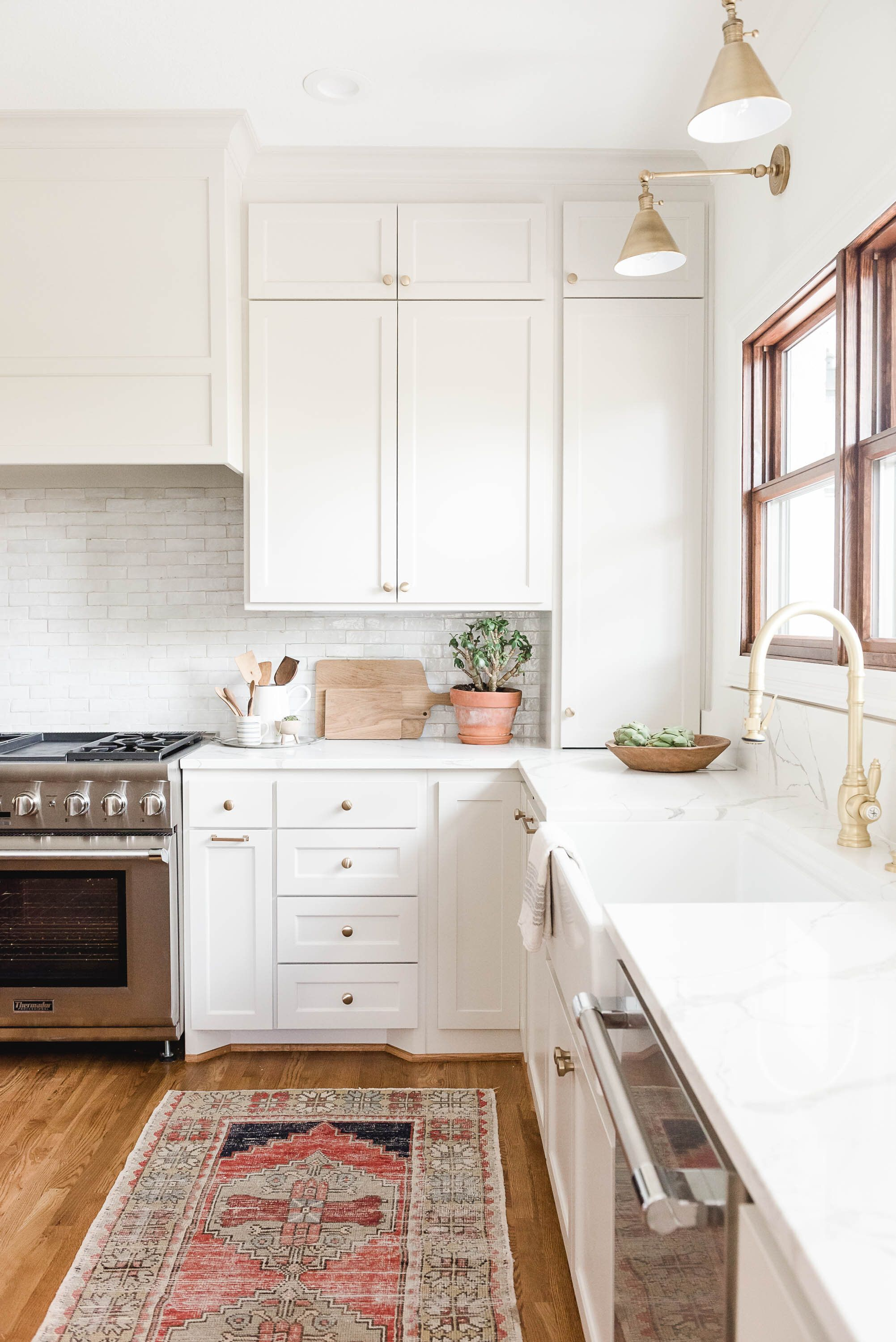 Modern Tudor Renovation High Street Homes In 2020 Kitchen Cabinets And Countertops White Kitchen Quartz White Kitchen Countertops