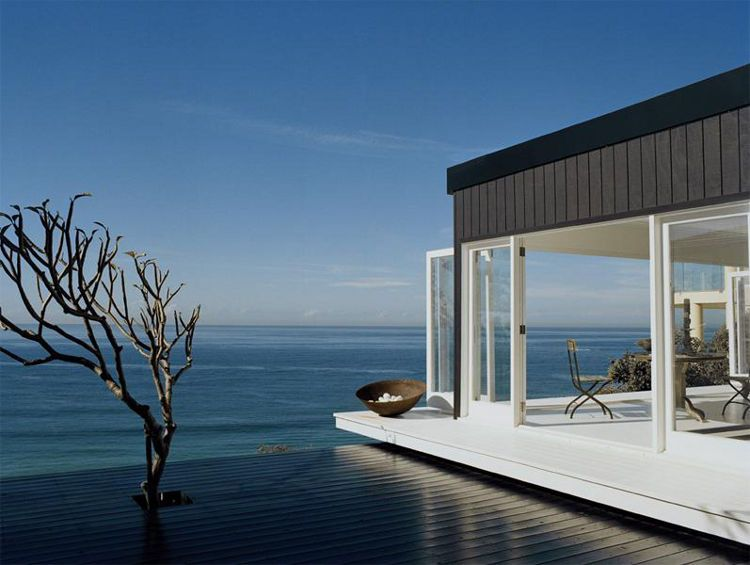 Beachhouse.  Amazing use of blue on the deck... fades right into the ocean.