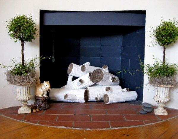 How to Beautify an Unused Fireplace in your Home.  (I pinned for the Angel Vine topiaries ~ Iridescence.)